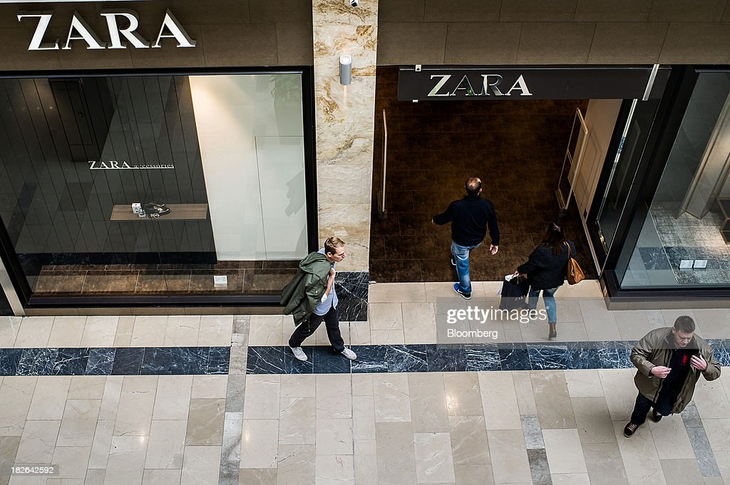 Customers enter a Zara fashion store, operated by Inditex SA, inside the Arena shopping mall in Budapest, Hungary, on Wednesday, Oct. 2, 2013. 'The retail sales environment in Europe, especially in Spain, has become less challenging in the last few weeks, while the weather overall has also been more stable,' Anne Critchlow, a London-based analyst at Societe Generale, said. Photographer: Akos Stiller/Bloomberg via Getty Images