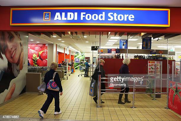 Customers enter an Aldi Stores Ltd food store in Sydney Australia on Thursday June 25 2015 Australia's biggest supermarkets are losing favor with...