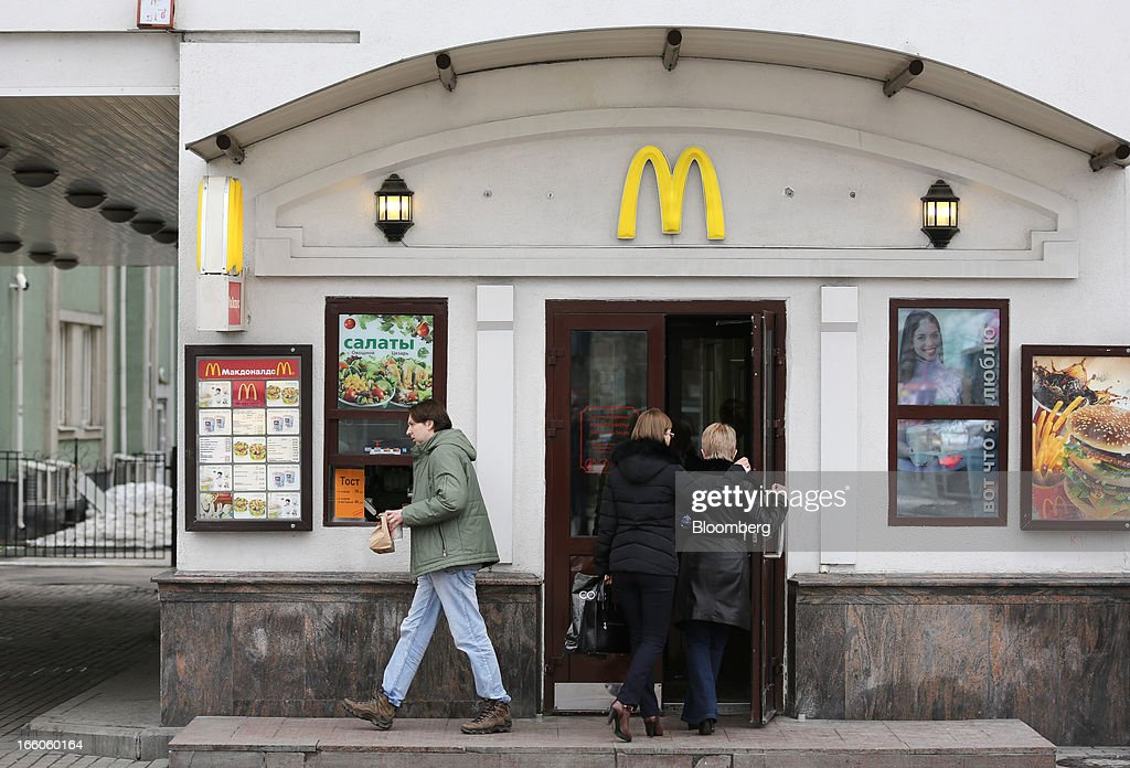 Customers enter and exit a McDonald's food restaurant in Moscow, Russia, on Sunday, April 7, 2013. McDonald's Corp., which virtually created the market for burgers and fries in the country and convinced Russians it's OK to eat with their hands, must fend off a growing challenge from rivals Burger King Worldwide Inc., Subway Restaurants, Yum! Brands Inc. and Wendy's Co. Photographer: Andrey Rudakov/Bloomberg via Getty Images