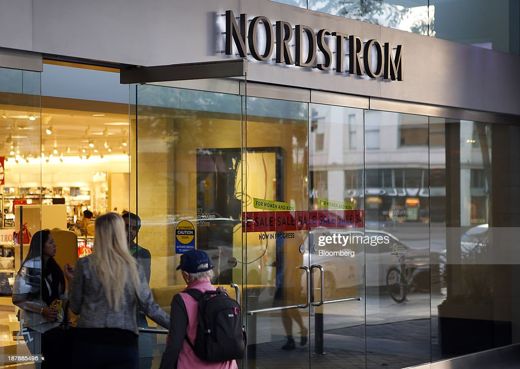 Customers enter and exit a Nordstrom Inc. department store in Santa Monica, California, U.S., on Tuesday, Nov. 12, 2013. Nordstrom Inc. is scheduled to release earnings figures on Nov. 14. Photographer: Patrick T. Fallon/Bloomberg via Getty Images