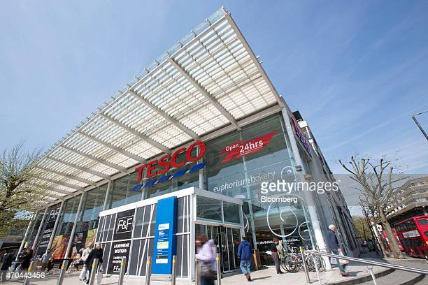 Customers enter and exit a Tesco supermarket operated by Tesco Plc in London UK on Monday April 20 2015 Tesco's April 22 results will serve as a...
