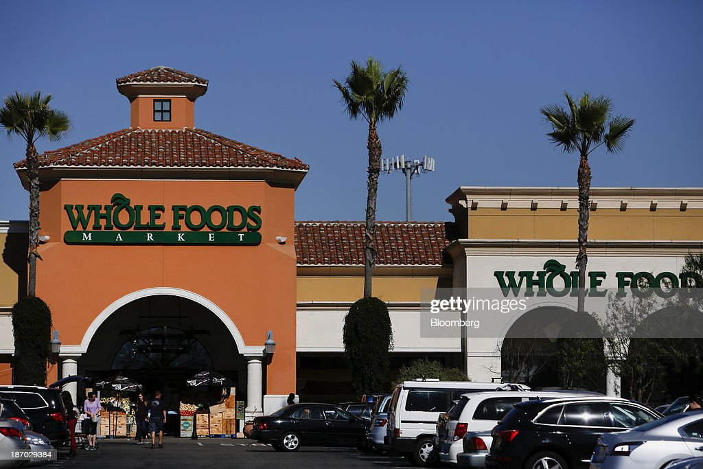 Customers enter and exit a Whole Foods Market Inc. location in El Segundo, California, U.S., on Tuesday, Nov. 5, 2013. Whole Foods Market Inc. is scheduled to release earnings figures on Nov. 6. Photographer: Patrick T. Fallon/Bloomberg via Getty Images