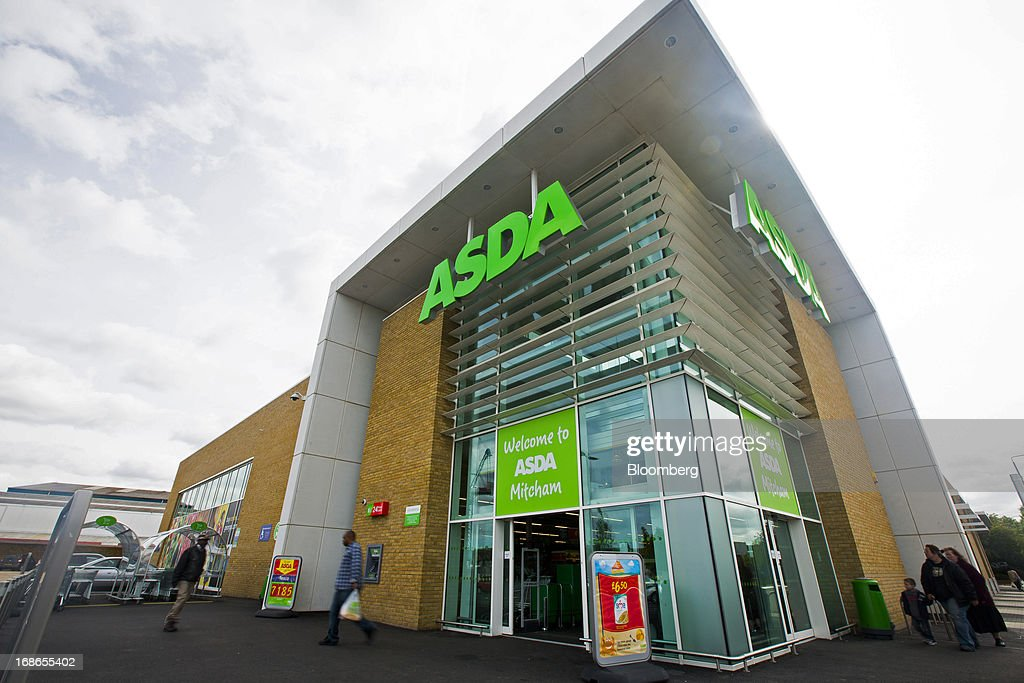Customers enter and exit an Asda supermarket store, operated by Wal-Mart Stores Inc., in the Merton borough of London, U.K., on Monday, May 13, 2013. Asda, the U.K. supermarket chain owned by Wal-Mart Stores Inc., said sales rose 4.5 percent last year and it's investing 700 million pounds ($1 billion) into stores and online operations. Photographer: Jason Alden/Bloomberg via Getty Images