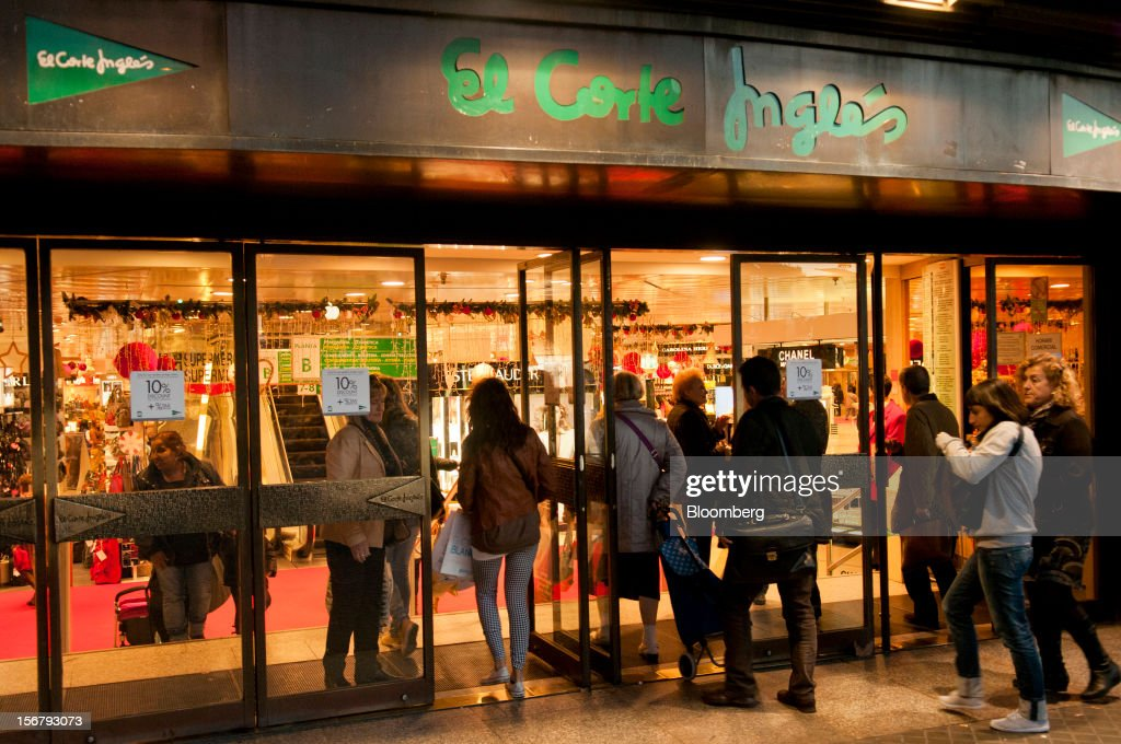 Customers enter and exit the El Corte Ingles department store in Barcelona, Spain, on Tuesday, Nov. 20, 2012. Bank of Spain Governor Luis Maria Linde said the government risks missing its budget targets this year and next, adding to doubts on Prime Minister Mariano Rajoy's ability to cut the deficit amid a five-year slump. Photographer: Stefano Buonamici/Bloomberg via Getty Images