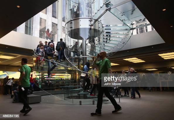 Customers enter Apple's Fifth Avenue store on Earth Day in Midtown Manhattan on April 22 2014 in New York City The store is one of at least 120 Apple...