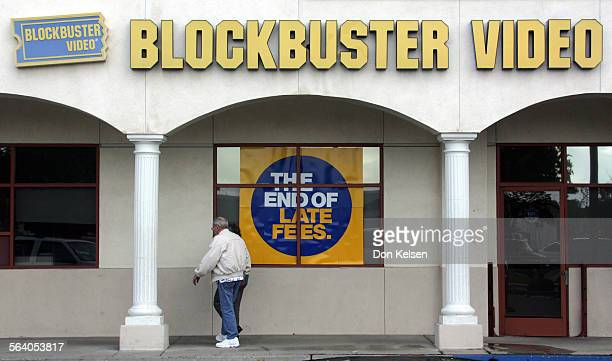 Customers enter Huntington Beach Calif Blockbuster Video store where large signage about company policy is posted in window The state of New Jersey...