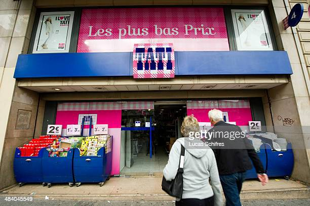 Customers enter Tati's historic first store under renovation on September 30 in Paris France Tati is a brand of discounted stores originally created...