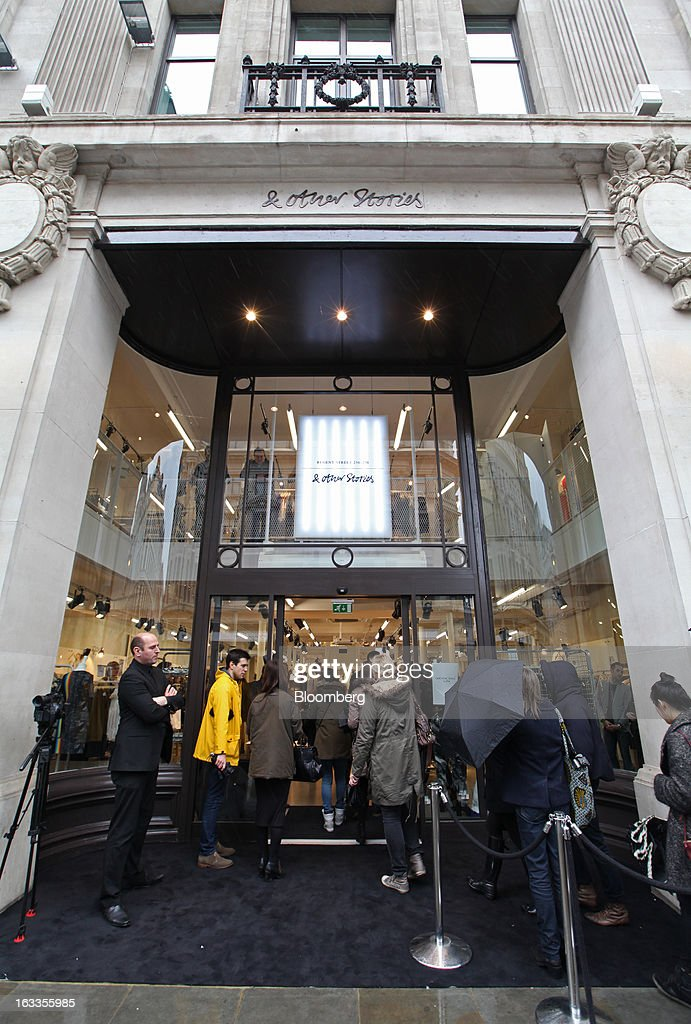 Customers enter the new '& Other Stories' store operated by Hennes & Mauritz AB (H&M) on the launch day in London, U.K., on Friday, March 8, 2013. The Swedish retailer is diversifying with a sixth brand after falling behind larger competitor Inditex SA in the race for the price-sensitive fashionista's euro. Photographer: Chris Ratcliffe/Bloomberg via Getty Images