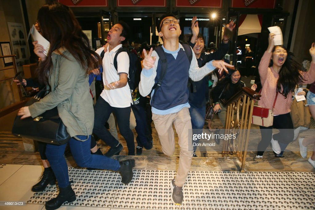 Customers enter the the David Jones city store in the early hours of the morning at the start of Boxing Day sales on December 26 2013 in Sydney...