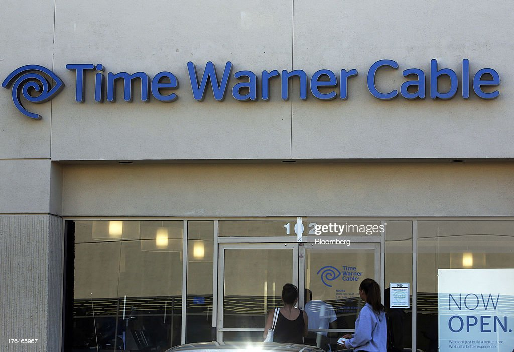 Customers enter the Time Warner Cable store in Torrance, California, U.S., on Monday, Aug. 12, 2013. Time Warner Cable Inc. said it's talking with CBS Corp., after a breakdown in negotiations led the cable provider to block its customers from seeing the network. Photographer: Patrick Fallon/Bloomberg via Getty Images