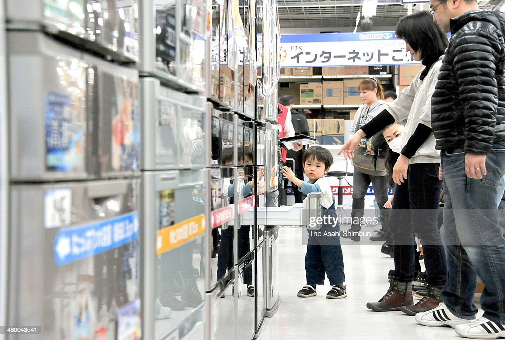Customers examine refrigerators ahead of the consumption tax hike at Bic Camera Ikebukuro branch on March 18, 2014 in Tokyo, Japan. Japan raises consumption tax from 5 to 8 percent on April 1, and possibly to 10 percent in October 2015, despite market concerns about a slowing of the economic recovery.