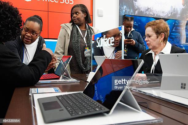 Customers examine the Microsoft Surface at Microsoft's first flagship store on Fifth Avenue on October 26 2015 in New York City Hundreds of eager...