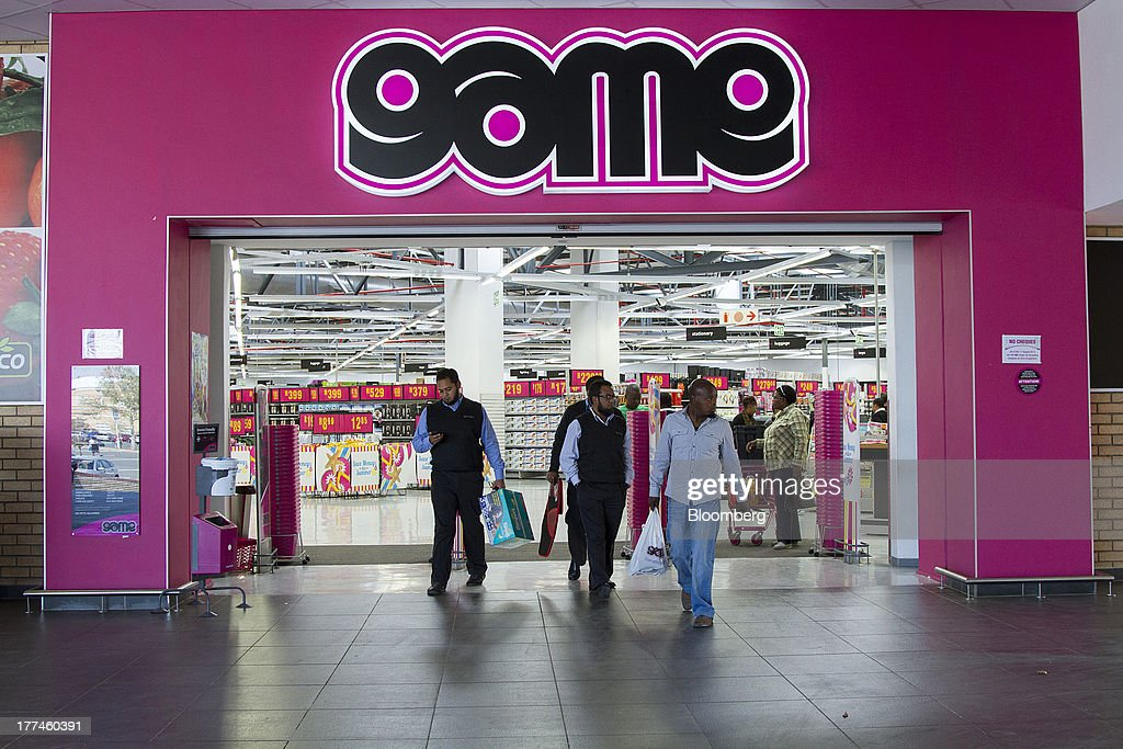 Customers exit a Game supermarket, part of Massmart Holdings Ltd., in the Fourways district of Johannesburg, South Africa, on Thursday, Aug. 22, 2013. Massmart Holdings Ltd., the South African food and goods wholesaler owned by Wal-Mart Stores Inc., said revenue growth continued to slow in August after a downturn in consumer spending hurt first-half earnings. Photographer: Nadine Hutton/Bloomberg via Getty Images