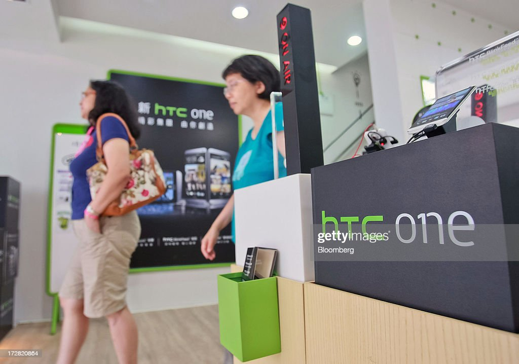 Customers exit a HTC Corp. store in Taipei, Taiwan, on Thursday, July 4, 2013. HTC is scheduled to announce second quarter earnings on July 8. Photographer: Maurice Tsai/Bloomberg via Getty Images