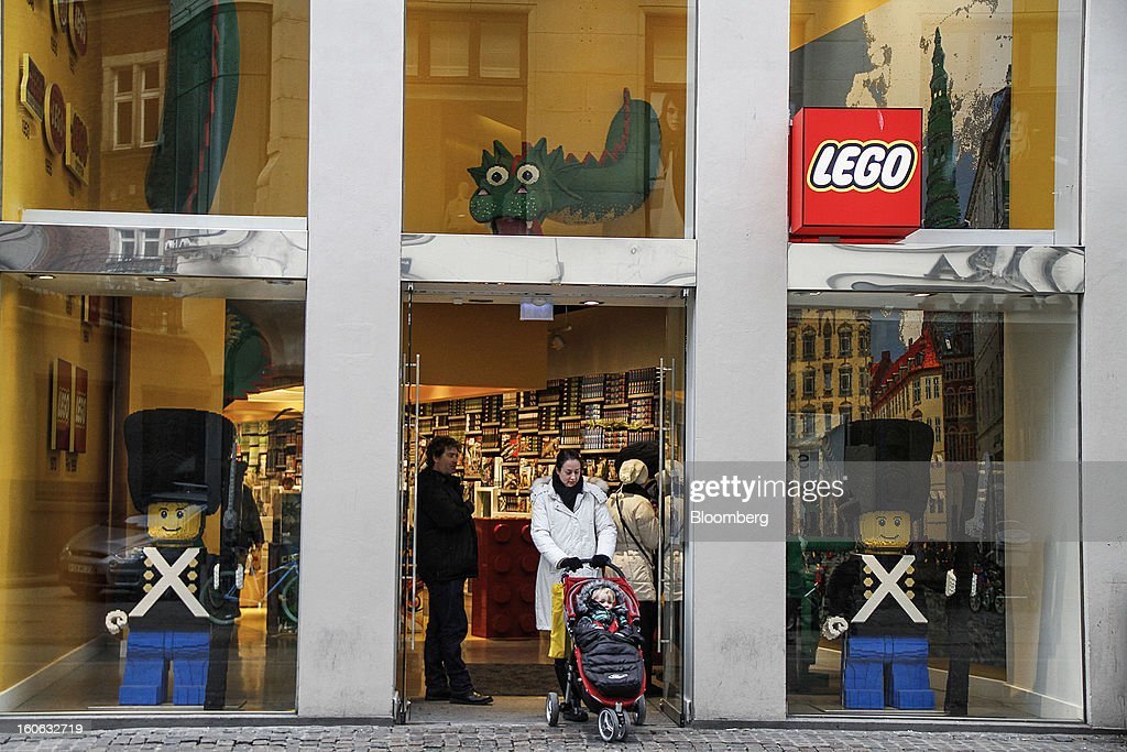 Customers exit a Lego A/S toy store in Copenhagen, Denmark, on Friday, Jan. 11, 2013. The 'Lego Friends' series, introduced in January in most markets, is Lego's sixth attempt over the years to target girls and the 'most significant' new product in a decade, according to Chief Executive Officer Joergen Vig Knudstorp. Photographer: Freya Ingrid Morales/Bloomberg via Getty Images