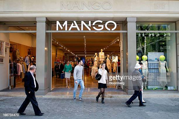 Customers exit a Mango fashion store in Barcelona Spain on Tuesday April 16 2013 Mango has ditched the glitz in favor of more casual attire like that...