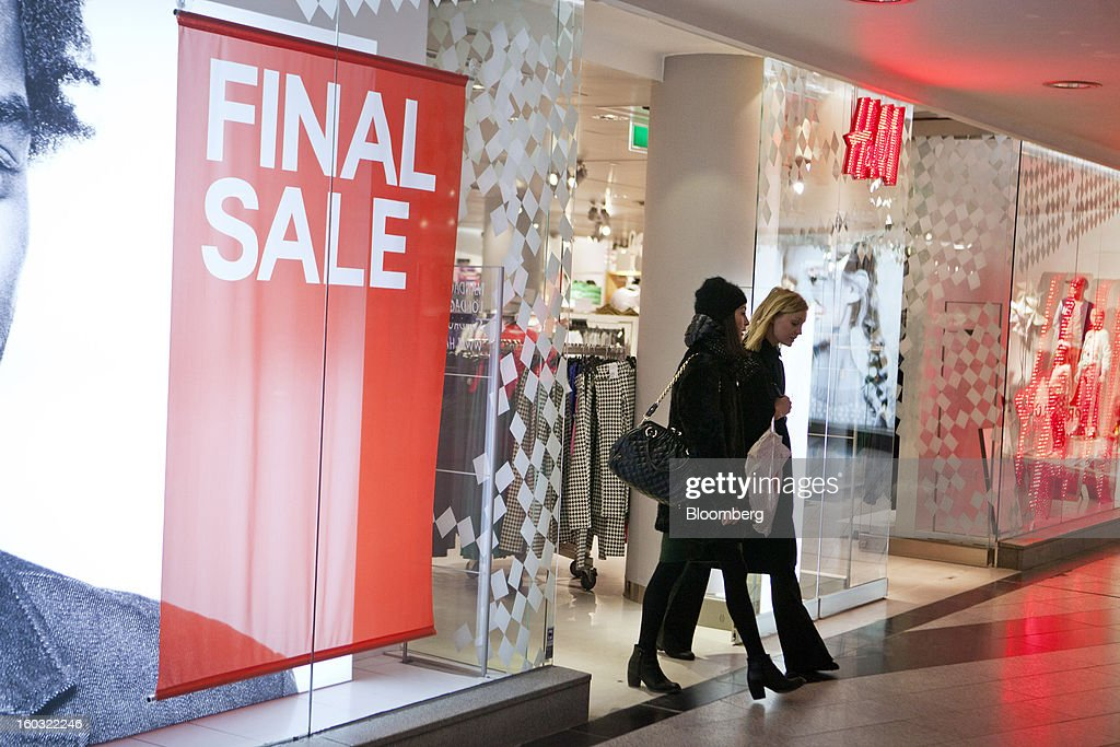 Customers exit an Hennes & Mauritz AB (H&M) store displaying a final sale sign in Stockholm, Sweden, on Tuesday, Jan. 29, 2013. Hennes & Mauritz AB, Europe's second-largest clothing retailer, reported sales growth that beat analysts' estimates for a second consecutive month as the chain offered markdowns in advance of the Christmas holiday. Photographer: Casper Hedberg/Bloomberg via Getty Images