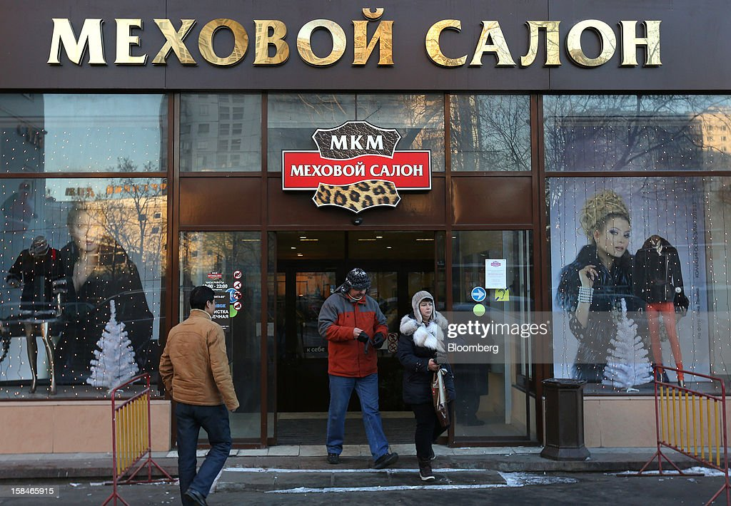 Customers exit the World of Fur and Leather store in Moscow, Russia, on Sunday, Dec. 16, 2012. Russia's government should introduce a tax on luxury consumption in first half of 2013, President Vladimir Putin said in state-of-the-nation address in Moscow. Photographer: Andrey Rudakov/Bloomberg via Getty Images