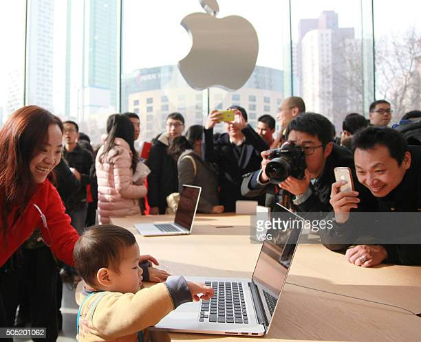 Customers experience Apple products as Nanjing opens second Apple Store on January 16 2016 in Nanjing Jiangsu Province of China Apple Inc has opened...