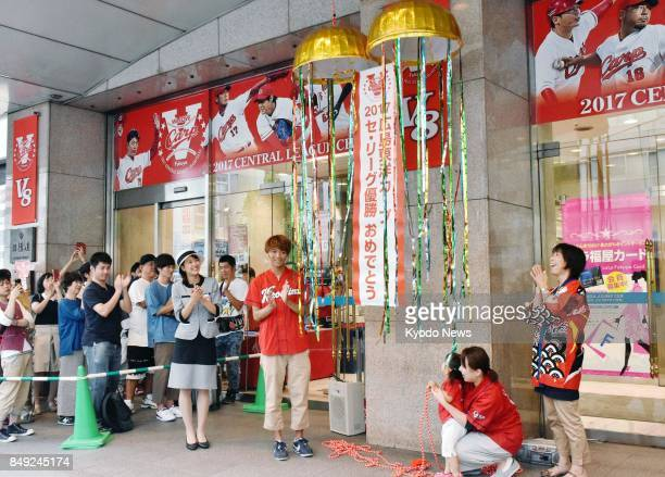 Customers gather at Fukuya department store in Hiroshima on Sept 19 for a sale to celebrate the Hiroshima Carp's second consecutive Central League...