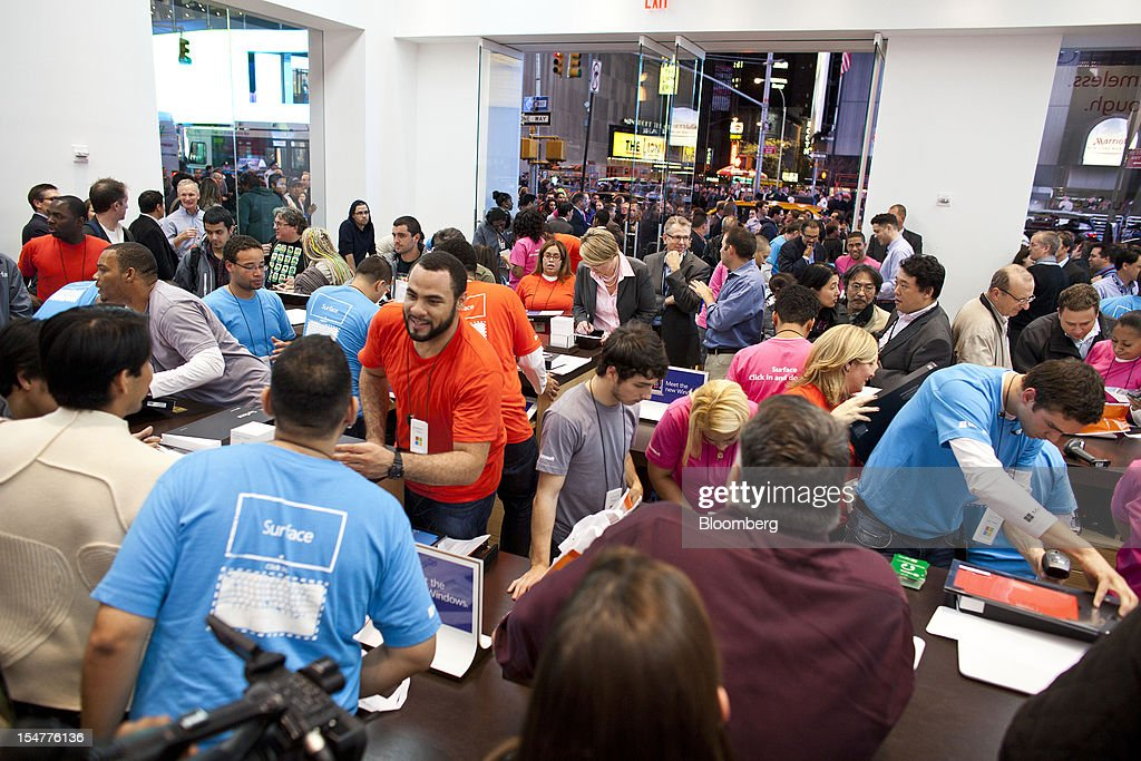 Customers gather inside the Microsoft Corp. store during its grand opening in New York, U.S., on Thursday, Oct. 25, 2012. Microsoft Corp. introduced the biggest overhaul of its flagship Windows software in two decades, reflecting the rising stakes in its competition with Apple Inc. and Google Inc. for the loyalty of customers who are shunning personal computers and flocking to mobile devices. Photographer: Ramin Talaie/Bloomberg via Getty Images