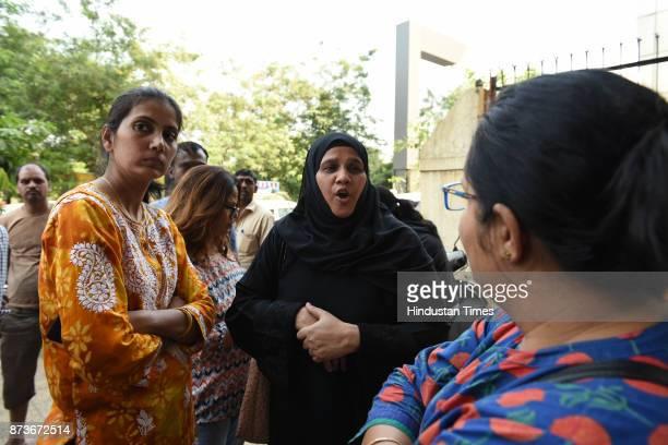 Customers gathered at the gate of Bank of Baroda Juinagar Branch after the news of bank robbery spread on November 13 2017 in Navi Mumbai India...