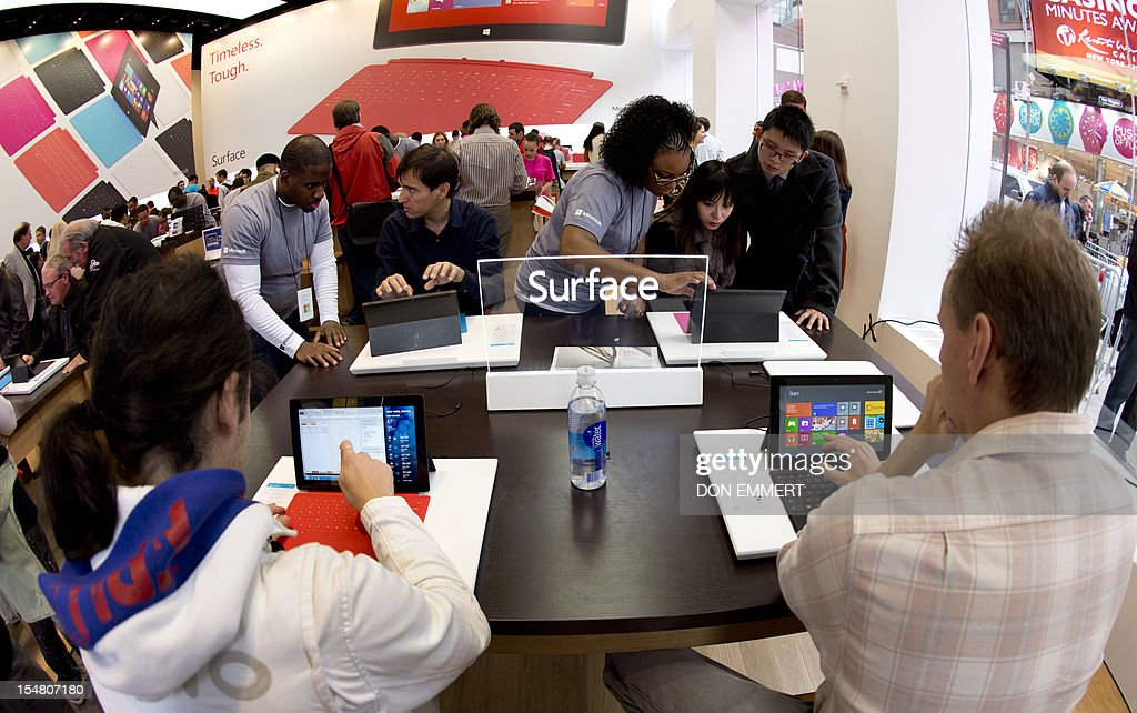 Customers get a look at products at Microsoft's pop-up store, set up on the corner of 46th Street in Times Square to mark the release of its Surface tablet on October 26, 2012 in New York. The store is one of more than 30 stores around the US showing off the Microsoft Surface and the new Windows 8 operating system.