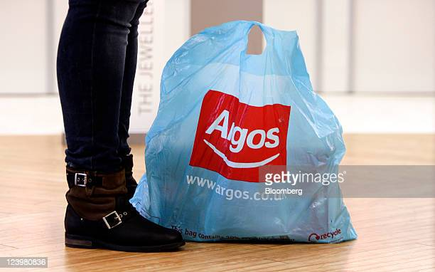 A customer's goods sit in a branded shopping bag at an Argos store operated by Home Retail Group Plc in Enfield UK on Wednesday Sept 7 2011 Home...
