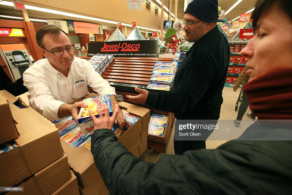 Customers grab Hostess Twinkies from John Kolton before he can replenish the display at a Jewel-Osco grocery store on December 11, 2012 in Chicago, Illinois. The Jewel-Osco grocery store chain purchased the last shipment of 20,000 boxes of Hostess products and put them on sale in their stores throughout the Chicago area today. Hostess Brands Inc. shut down its baking operations and began liquidating assets last month after failing to negotiate a labor contract with Workers with the Bakery, Confectionery, Tobacco Workers and Grain Millers International Union
