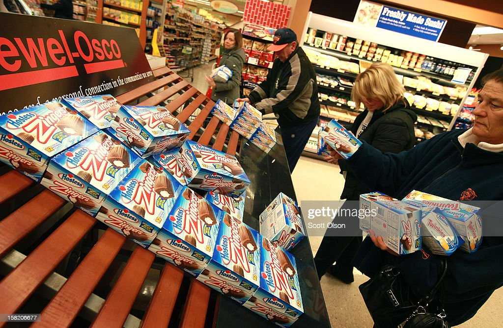 Customers grab up Hostess snacks at a Jewel-Osco grocery store on December 11, 2012 in Chicago, Illinois. The Jewel-Osco grocery store chain purchased the last shipment of 20,000 boxes of Hostess products and put them on sale in their stores throughout the Chicago area today. Hostess Brands Inc. shut down its baking operations and began liquidating assets last month after failing to negotiate a labor contract with Workers with the Bakery, Confectionery, Tobacco Workers and Grain Millers International Union