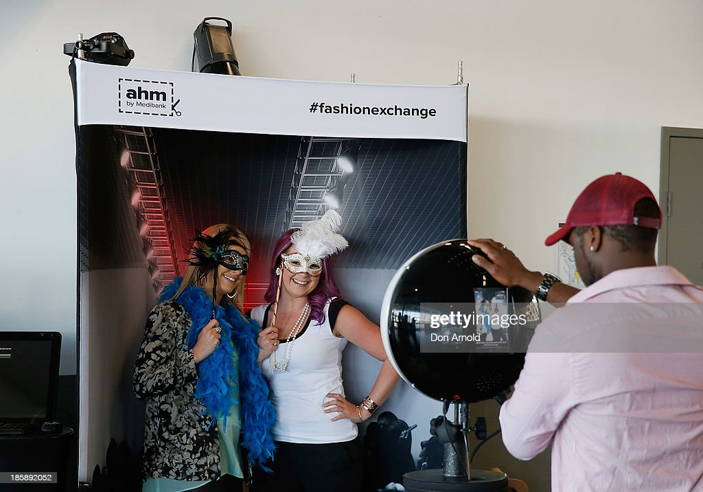 Customers ham it up in the photo booth at the AHM Fashion Exchange at The Overseas Passenger Terminal on October 26, 2013 in Sydney, Australia.