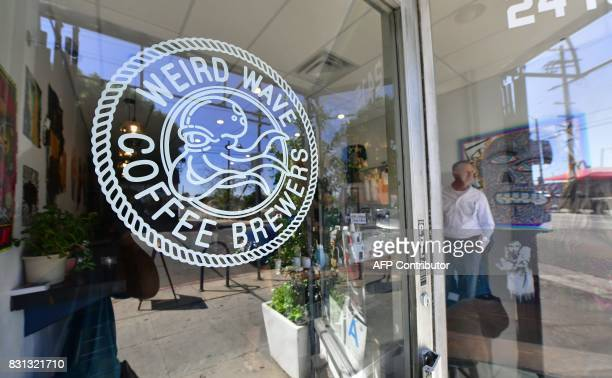 Customers have a cup of coffee at the Weird Wave Coffee Brewers in the Boyle Heights neighborhood of Los Angeles California on August 3 where some...
