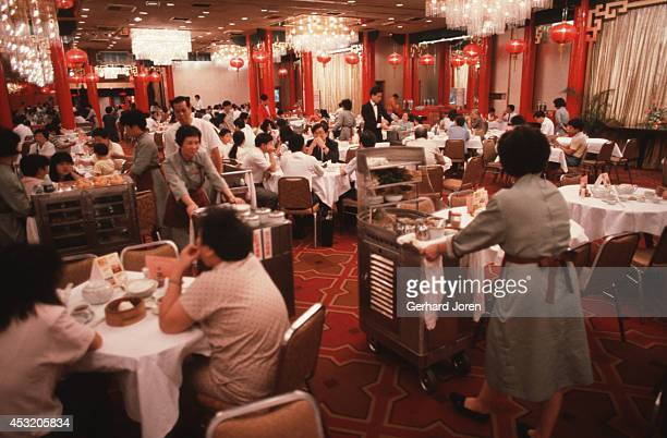 Customers having Dim Sum at a Chinese restaurant in Causeway bay on Victoria Island Hong Kong