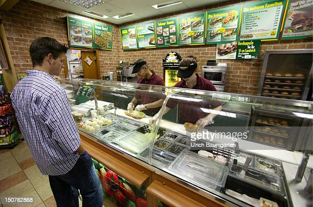 Customers in a branch of the US American sandwich fastfood chain Subway