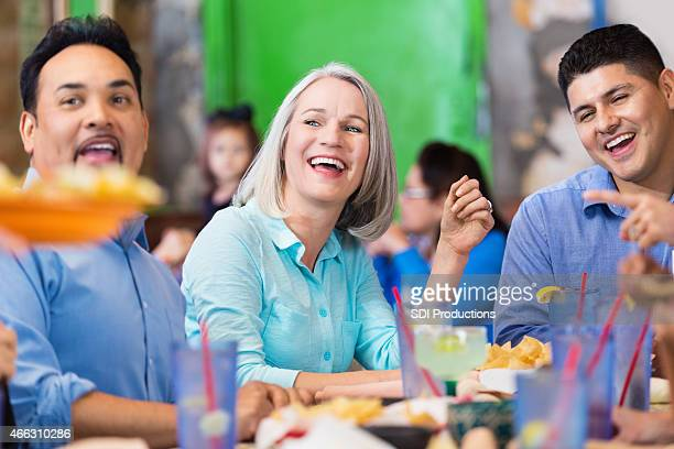 Customers in casual restaurant excited about meal