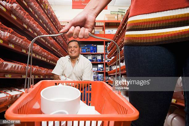 Customers in Hardware Store Aisle