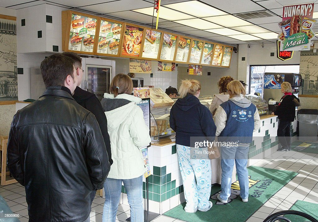 Customers in line are seen December 29, 2003 in Chicago. Subway restaurants today started to offer two Atkins Nutritionals, Inc.-endorsed low-carbohydrate wraps. The Turkey and Bacon Melt Wrap with Monterey cheddar cheese and the Chicken Bacon Ranch Wrap with Swiss cheese. Both Atkins-Friendly Wraps are available in the U.S. and Canada and have 11 grams Net Carbs or less. The wrap itself, which is made with wheat gluten, cornstarch, oat, sesame flour and soy protein, has only 5 grams Net Carbs. Subway Restaurants is the first quick serve restaurant to partner with Atkins Nutritionals Inc.