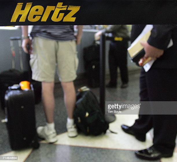Customers in line are visible beyond Hertz signage on stanchion strapping at its rentalcar pickup area July 17 2006 at O'Hare International Airport...