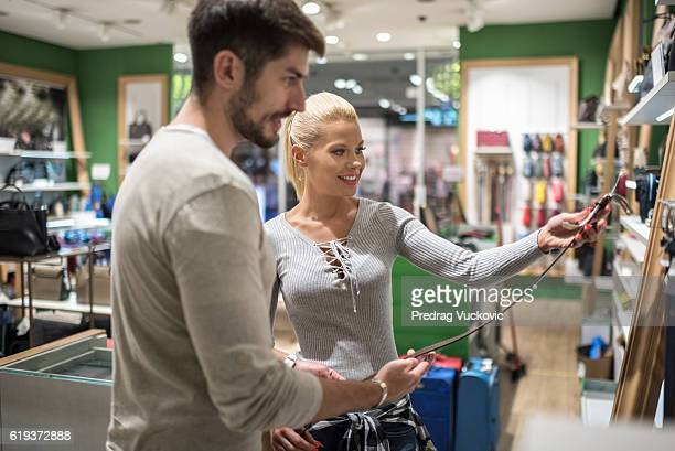 Customers inside luggage store
