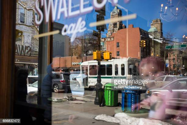 Customers inside the Swallow Cafe look onto vehicular traffic on Atlantic Avenue March 22 2017 in Brooklyn New York The demand for residential...