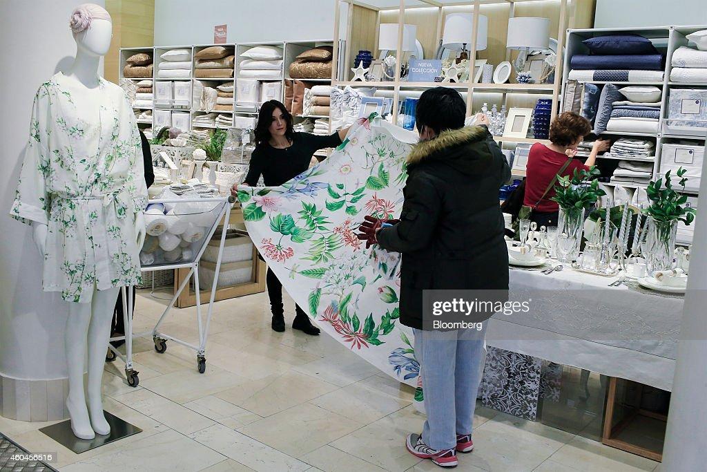 customers inspect goods for sale inside a zara home store. Black Bedroom Furniture Sets. Home Design Ideas