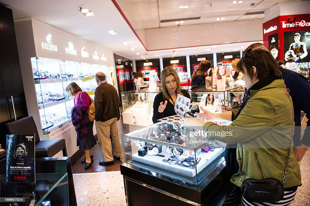 Customers inspect wristwatches for sale inside an El Corte Ingles SA department store in Barcelona, Spain, on Thursday, May 30, 2013. Spain's recession eased in the first quarter as domestic demand stabilized while exports, which the government says will drive the recovery of the euro-area's fourth-largest economy, fell at the fastest pace in a year. Photographer: David Ramos/Bloomberg via Getty Images