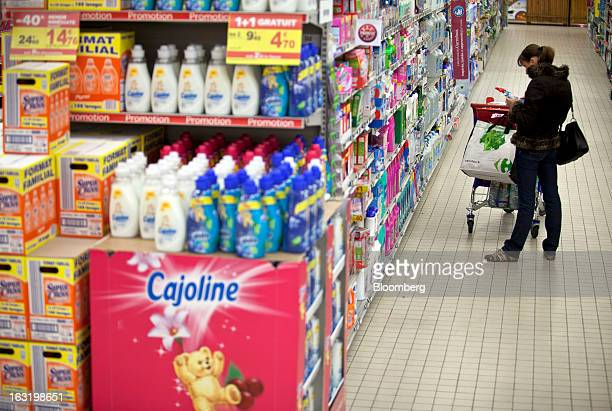 A customers inspects a cleaning product in the household detergents aisle inside a Carrefour SA supermarket in Portet sur Garonne near Toulouse...