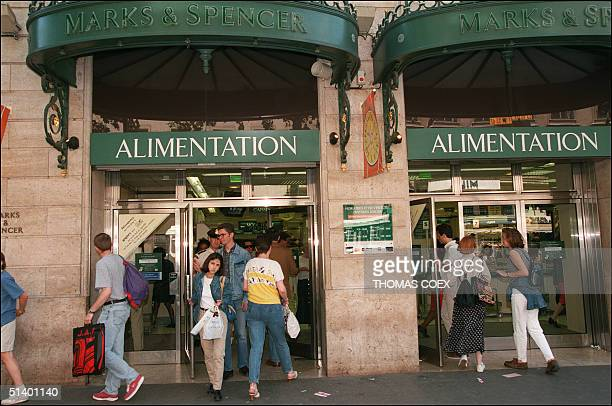 Customers leave 15 June 1996 Marks and Spencer food department in Paris reassured after the chain store ran an advertising campaign in French press...