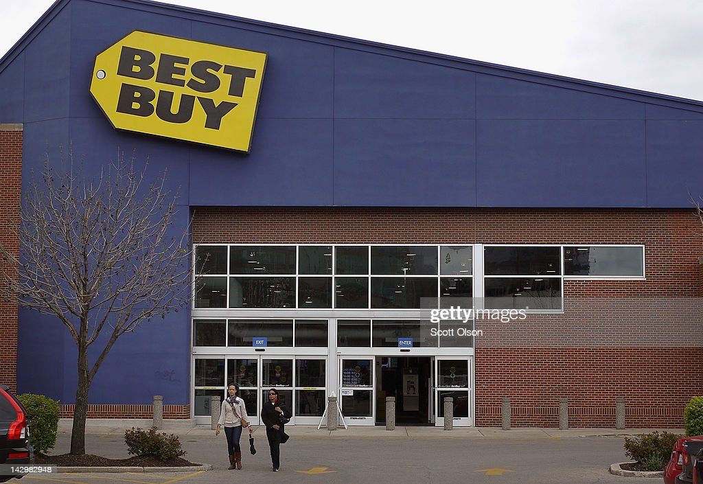 Customers leave a Best Buy store on April 16, 2012 in Chicago, Illinois. The struggling electronics retailer plans to close 50 stores nationwide in an attempt to cut $250 million in costs for the 2013 fiscal year.