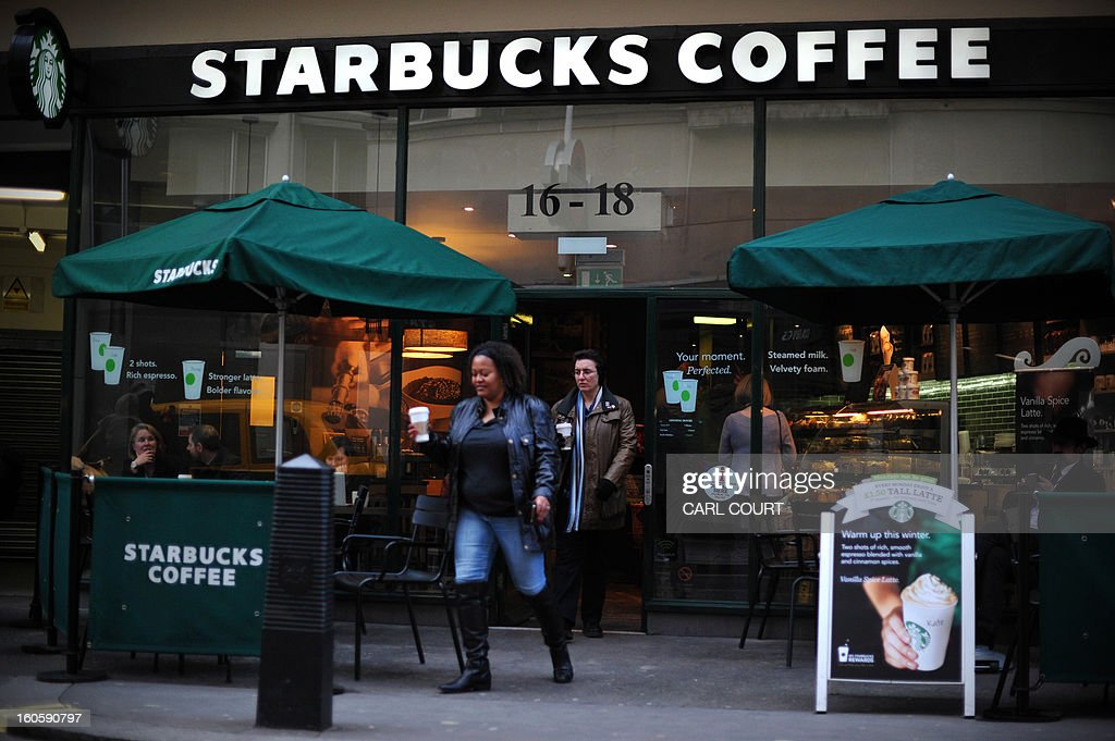 Customers leave a branch of Starbucks in central London on February 1, 2013. Despite pledging to pay millions of pounds in extra tax in Britain, Starbucks faces a battle to restore its reputation over its fiscal stance, with analysts saying the offer is 'too little too late'. AFP PHOTO / CARL COURT