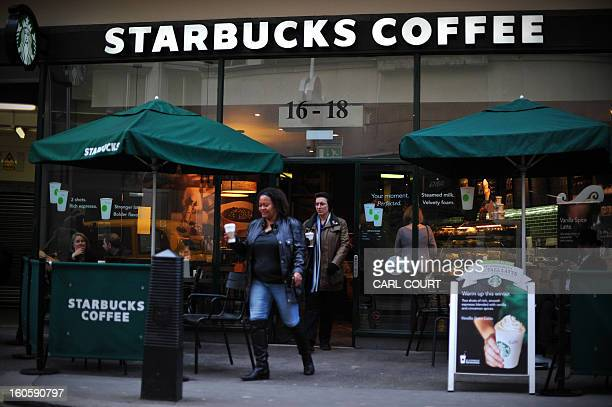 Customers leave a branch of Starbucks in central London on February 1 2013 Despite pledging to pay millions of pounds in extra tax in Britain...