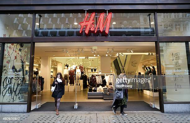 Customers leave a HM fashion clothing store operated by Hennes and Mauritz AB in London UK on Friday Oct 16 2015 Britain's inflation rate turned...