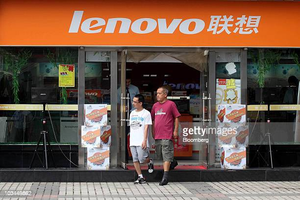Customers leave a Lenovo Group Ltd store at a computer market in Beijing China on Thursday Aug 19 2010 Lenovo Group Ltd China's biggest maker of...