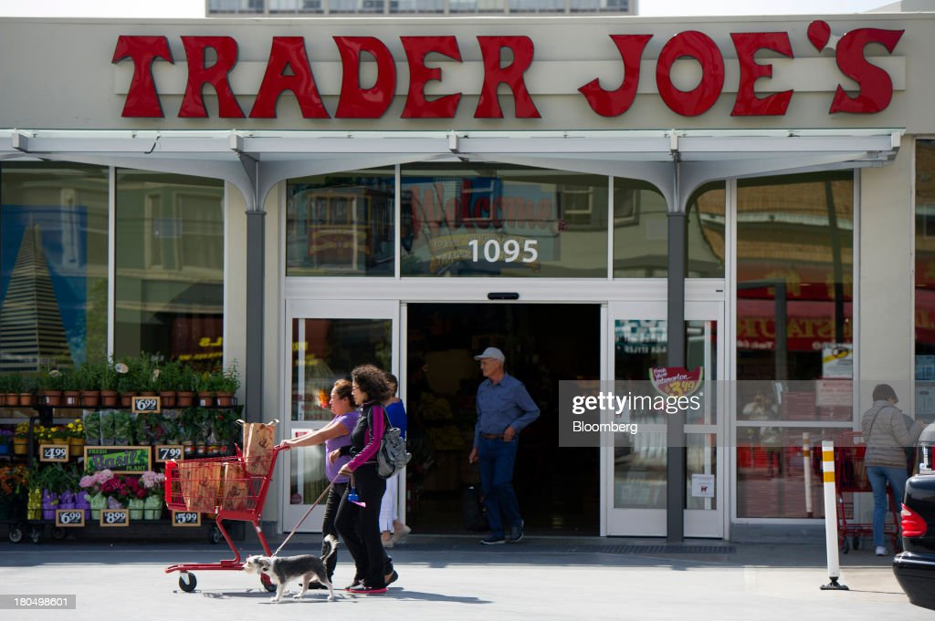 Customers leave a Trader Joe's Co. store in San Francisco, California, U.S., on Friday, Sept. 13, 2013. Trader Joe's Co., the closely held grocery store chain, will end health benefits for part-time workers next year, directing them instead to anew insurance marketplaces as companies revamp medical coverage to fit the U.S. Affordable Care Act. Photographer: David Paul Morris/Bloomberg via Getty Images